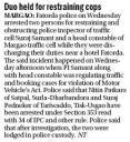 Duo held for restraining cops.JPG -