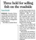 Three held for selling fish on the roadside.jpg -